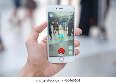 """Pokemon Go"" application reality game in smartphone, the Pokemon appear among people, Bangkok, Thailand : 12 August 2016"