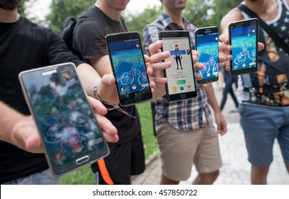 Pokemon GO augmented reality smartphone game players and trainers play together in the park while in attempt to catch all the pokemons, Plovdiv, Bulgaria, July 24, 2016.