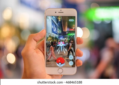 """""""Pokemon Go"""" game application reality game in smartphone, let catch the Pokemon in the real world, Bangkok, Thailand : 12 August 2016"""
