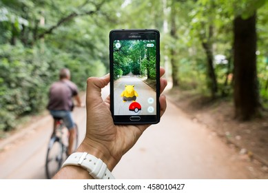 Pokemon GO ios and android smartphone game with augmented reality with Drowzee and biker, Sofia, Bulgaria, July 25, 2016.