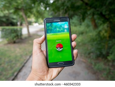 Pokemon GO ios and android smartphone game with augmented reality GOTCHA! pokeball in the park, Sofia, Bulgaria, July 28, 2016.