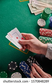 Poker, blackjack. Gaming business. Poker table with money, chips and a pair of aces. Internet poker, win