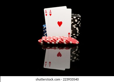 Poker cards on black background with reflexion