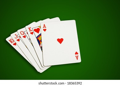 Poker cards on green  background, isolated, clipping path excludes the shadow.