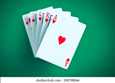 poker cards on green casino table
