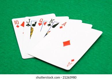 poker cards on green table studio shoot
