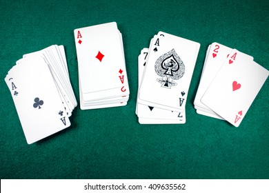 Poker Cards on Green Table.