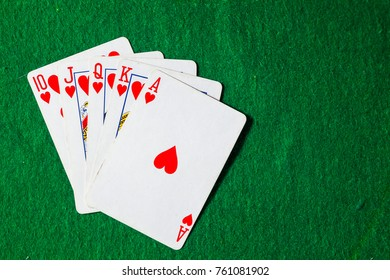 poker cards Royal Flush on green background with copy space