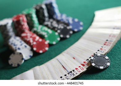 Poker chips and cards on the cloth