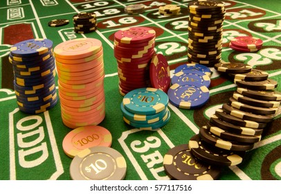 Poker chips and cards on a poker table at the casino