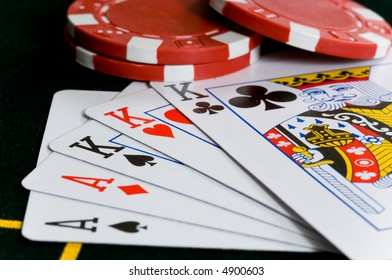 Poker Chips and hand of cards that makes a full house
