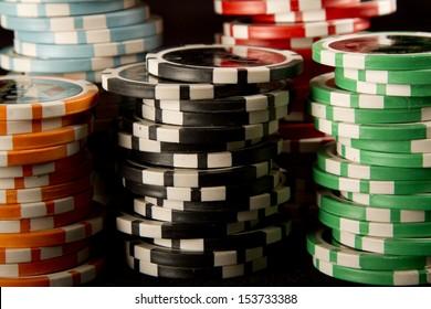 Poker chips on black background