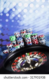 Poker Chips on a gaming with casino roulette