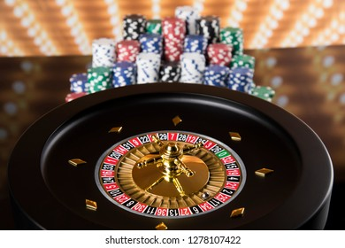 Poker Chips on gaming table, roulette wheel in motion, casino background