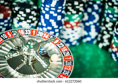 Poker Chips on a gaming table roulette Casino theme background