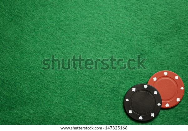 Poker chips on green cloth