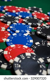 Poker chips on green table in casino