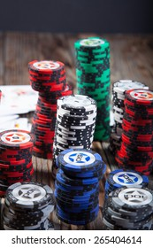 Poker chips on a wooden table