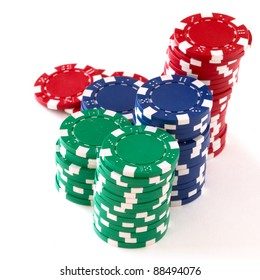 poker chips over white background