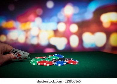 Poker chips with pair of cards on table in casino