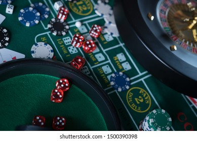 Poker Chips with roulette, gambling games concept.