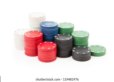 Poker coins stacked up together against a white background