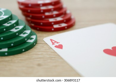 Poker game with ace of hearts and chips