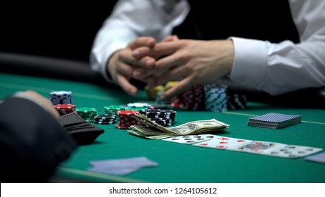 Poker game addicted person betting all money and chips, bad business investment