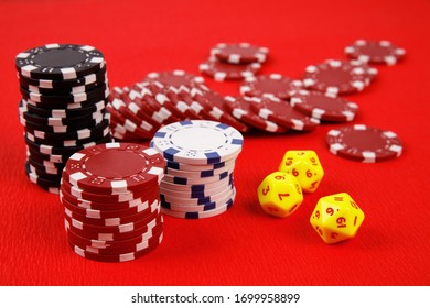 Poker game with chips and dices isolated on red  background