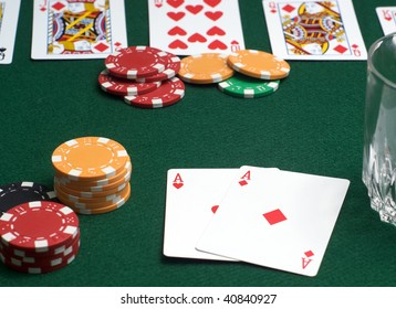 Poker game in progress - focus on players cards