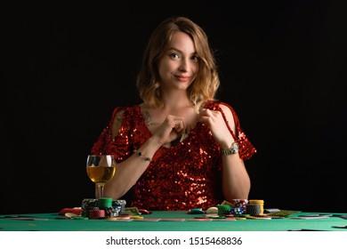 Poker girl wins a jackpot in a casino. On a black background. Winning in a casino.