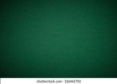 Poker green table in casino with lighting