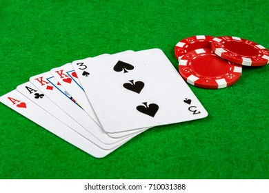 Poker hand showing two pair with betting chips
