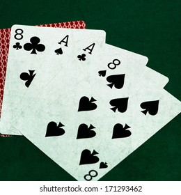 Poker Hands - Dead Man's Hand. Five playing cards forming the famous poker dead man's hand. The dead man's hand is a hand of two pair, consisting of black aces and eights. Square Texture added.