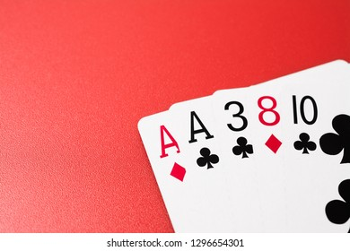Poker hands playing cards two aces on pair on a red background