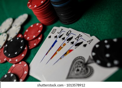 Poker Hands / Royal Flush 3. Five playing cards - the poker royal flush hand. Royal Flash, card deck, poker royal flash on cards and poker chips on green casino table. success in gambling. soft focus