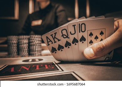 Poker Hands / Royal Flush. Five playing cards - the poker royal flush hand. Royal Flash, card deck, poker royal flash on cards and poker chips on green casino table. success in gambling. soft focus