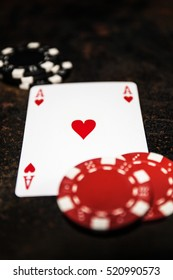 Poker play. Ace of hearts. Poker chips.