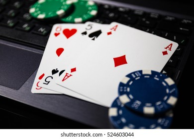 Poker play online. Poker cards and chips, dice on the keyboard.