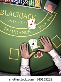 poker player at blackjack table in online casino
