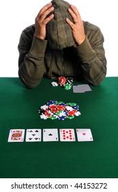 Poker player holding head in despair