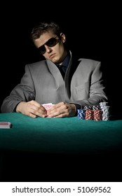 Poker player looking at his cards