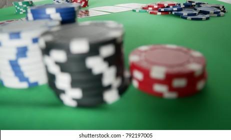 Poker Player Moves Casino Chips on Table. Winner In Poker. Poker Player Going All In