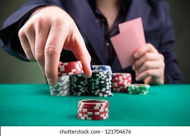 Poker player on black background