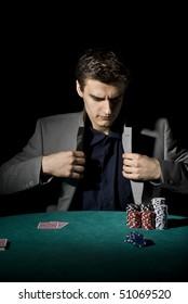 Poker player preparing for action