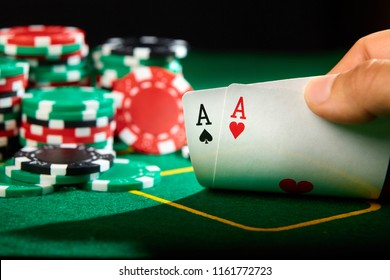 Poker player show a pair of aces.