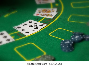 poker playing card on a green background - poker table