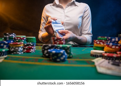 Poker. Playing cards in a casino. Dealer deals cards. Successful game. Online casino advertising.