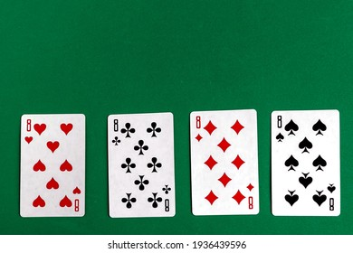 Poker quads playing card, green background, copy space