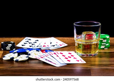 Poker scene with drink on a dusty wooden table